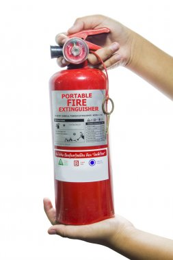 Mini red portable fire extinguisher on white background
