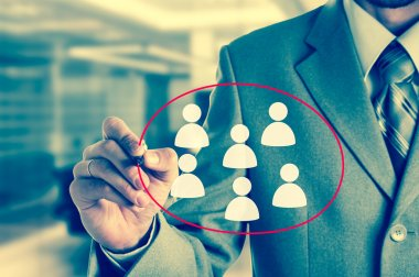 Hand pointing to businessman icon - HR, recruitment and chosen concept