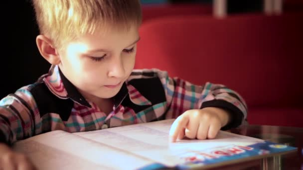 boy learning to read a book3