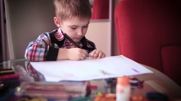 Little boy sitting at table and drawing10