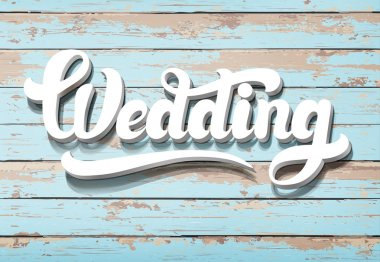 The word Wedding on a wooden background