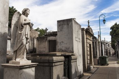 Angel guarding the graves of the dead.