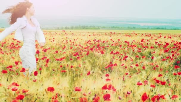 Woman running through poppies field