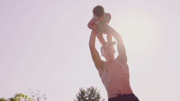 Father playing with baby daughter