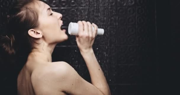 Woman singing in shampoo bottle