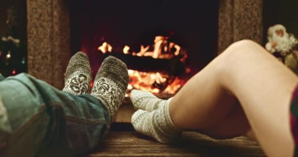 Feet in woolen socks warming