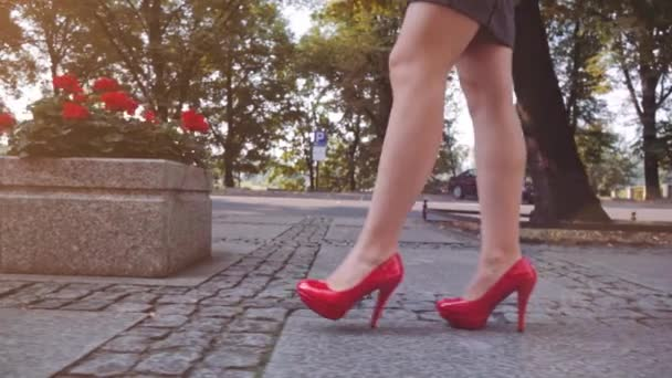 Woman walking in red shoes