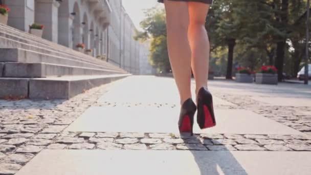 Sexy woman legs walking in city