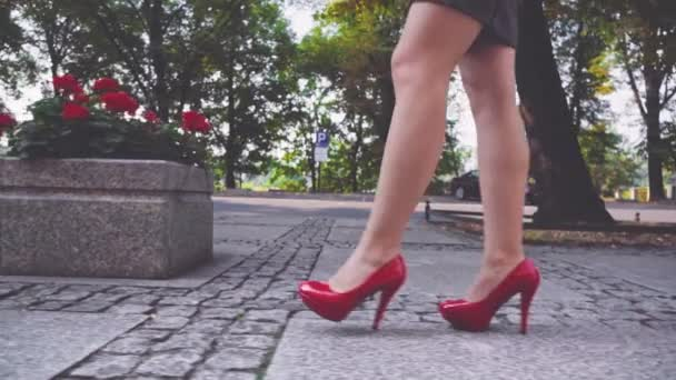 Woman walking in high heeled shoes