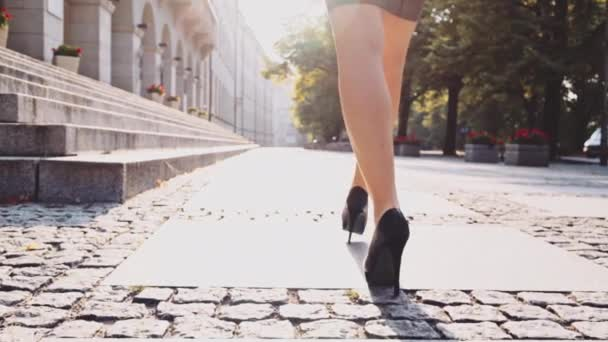 Sexy woman in black shoes walking