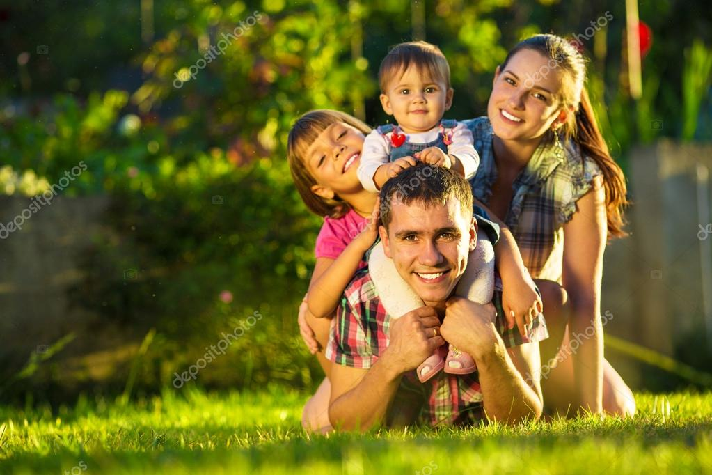 Family having fun outdoors in summer.