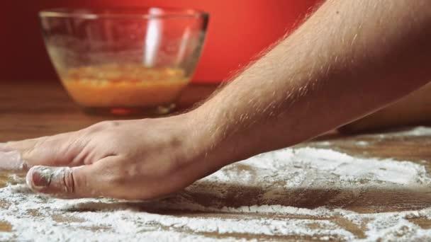 hand preparing flour