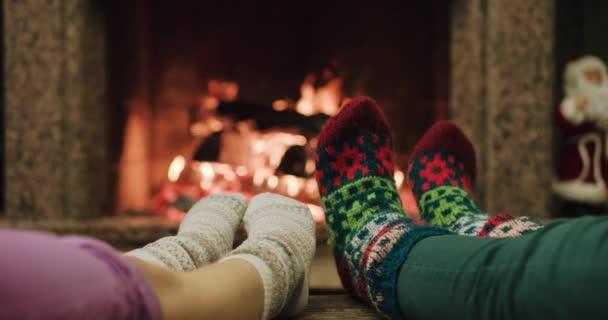 Feet warming by cozy fire