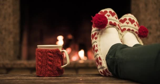 Woman relaxes by warm fire