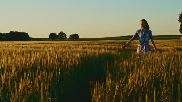 girl running on wheat field