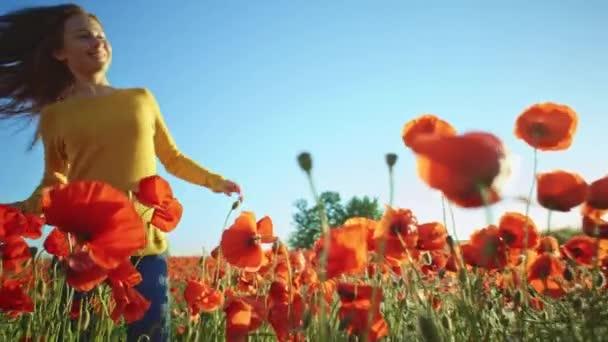 girl having fun in poppies field