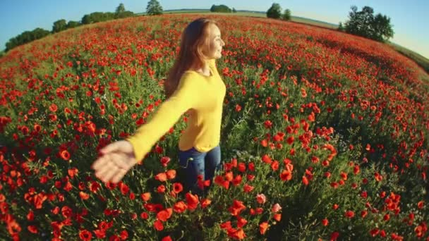girl having fun in poppies field