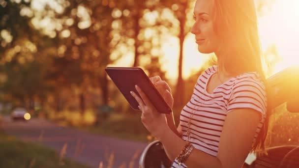 Woman using digital tablet