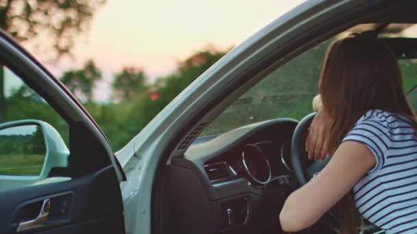 woman resting on car wheel