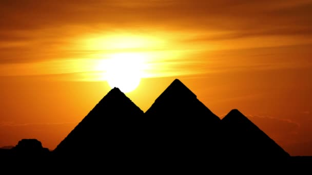 Sun goes behind great pyramids in Giza valley during gorgeous sunset