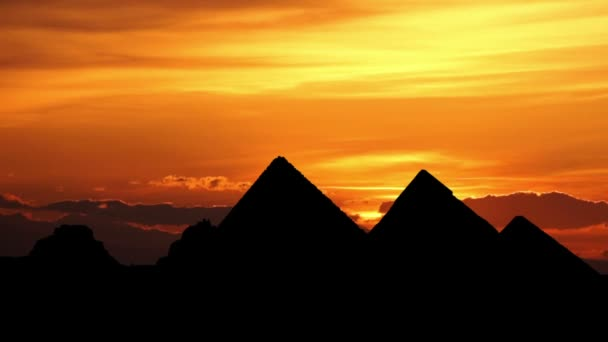 Sunrise behind great pyramids in Giza valley