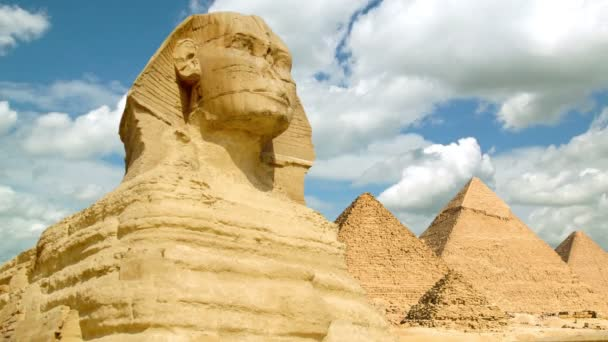 Timelapse of the famous Sphinx with great pyramids in Giza valley