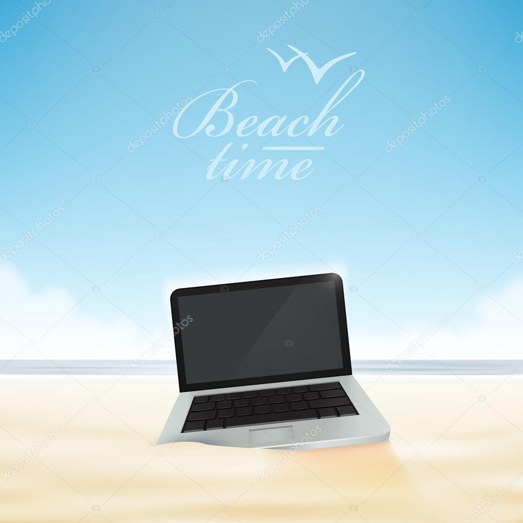 Laptop computer in the beach sand.