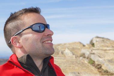 Woman reflected on man sunglasses