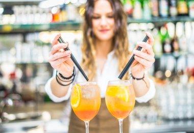 Barmaid preparing cocktails