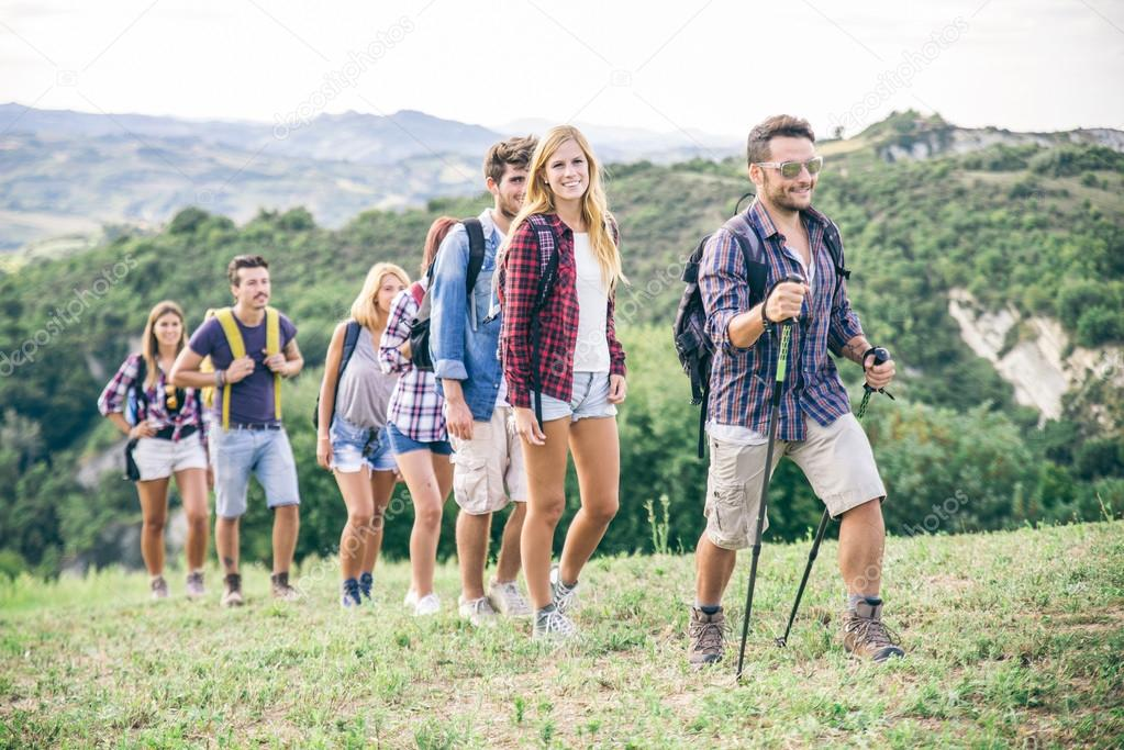 Group of hikers walking in the nature