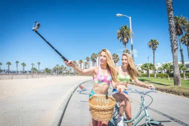 Two girls cycling