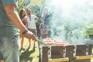 Group of friends making barbeque