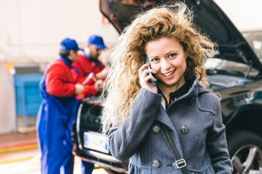 Woman calling car assistance service