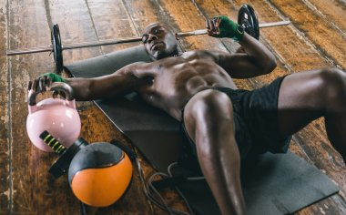 Black fighter training hard in his gym