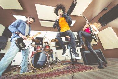 Rock band playing hard rock