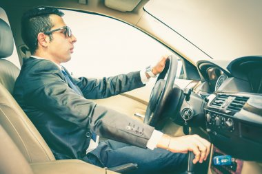 Business man driving his car