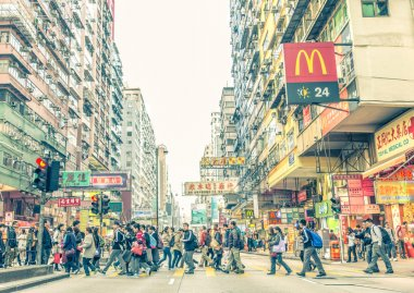 HONG KONG - FEBRUARY 12,2015:  People crossing streets in Hong Kong.There are more than 35 million of visitors arrived Hong Kong from January to September stock vector