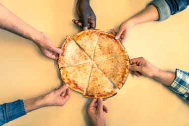 Friends taking a slice of pizza