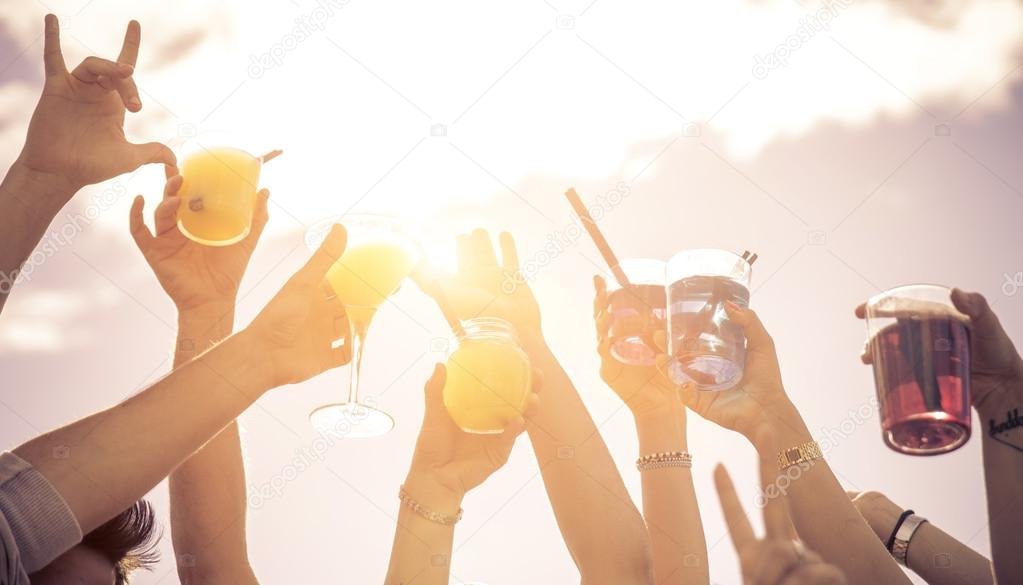 hands up to the sky with cocktails