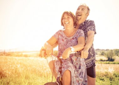 middle age couple going for a ride with the bicycle in the countryside
