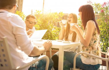 group of friends having a coffee outdoor