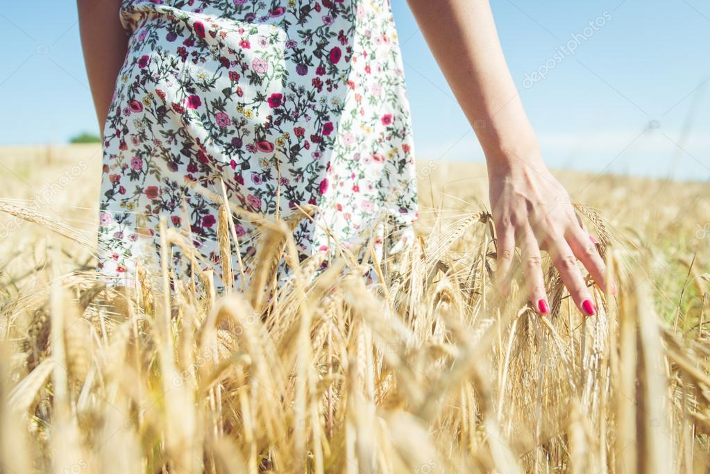 woman walking in the wheat