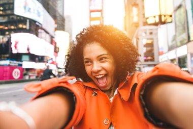Afro american woman taking selfie