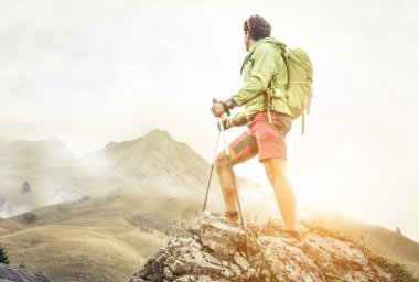 hiker climbing on the mountains