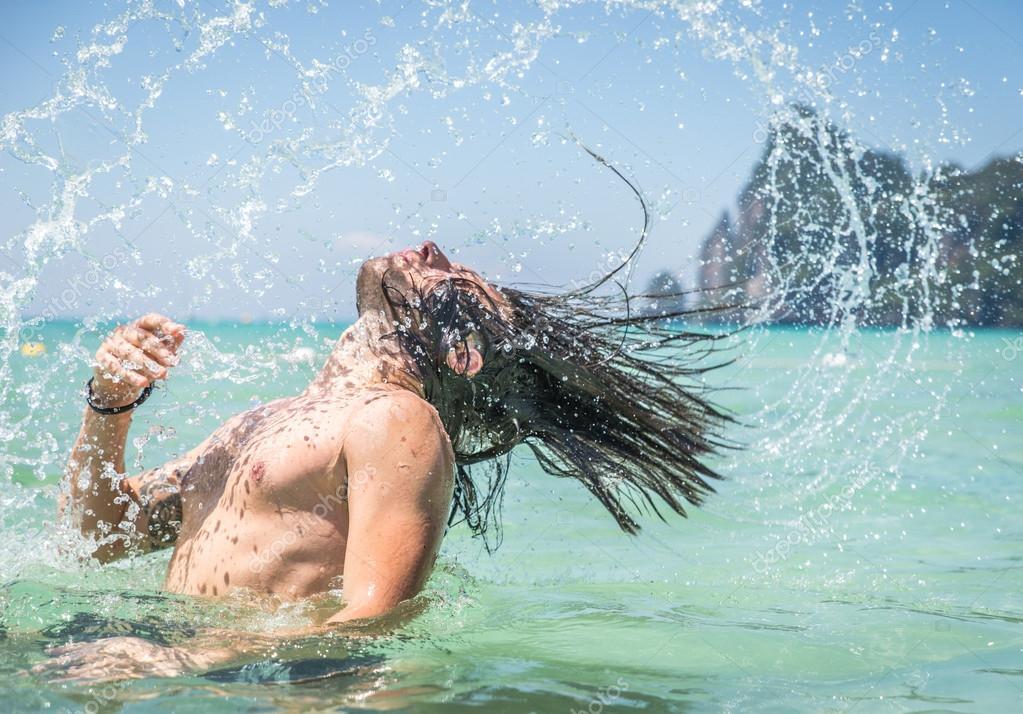 Beautiful man splashing water