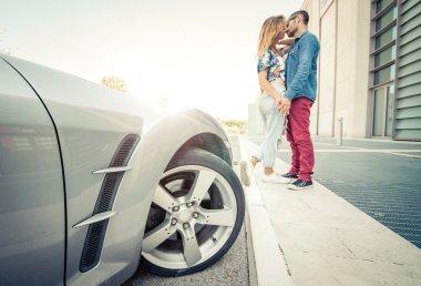 couple kissing outside the car