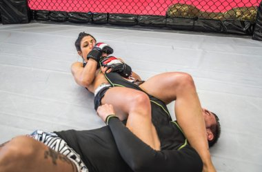 Couple making mma training in the cage