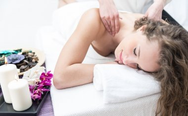 Young woman having massage in a saloon