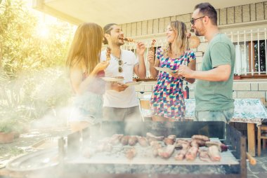 Group of friend having lunch in the backyard. making barbecue outdoor with differnt kind of meat and vegetables stock vector