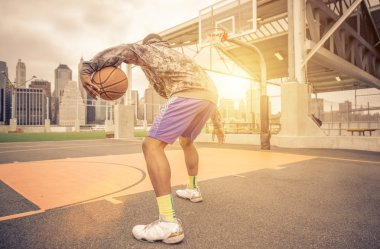 Basketball player training on the court